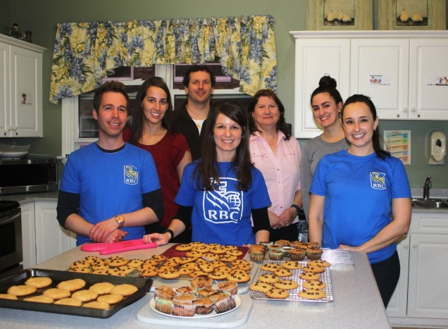 RBC Volunteers in front of baked goods.